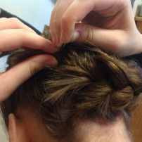 Pin the loose braid under the base of your head, connecting it with your starting point.